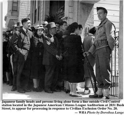 soldier guards doorway to Japanse American Citizen's League Building at 2031 Bush St. as Japanese line up for transportation under Gen. DeWitt's exclusion order no. 20. Caption by the War Relocation Authority. Photo by Dorothea Lange