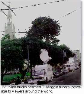 TV uplink trucks at Washington Square park beamed coverage of  Joe Di Maggio's funeral procession to the world.
